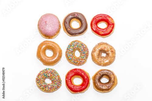 Poster Colorful glazed donuts, view form the top,  isolated on white background