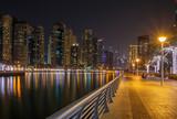 pedestrian walkway in district Marina at night