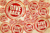 give back, red stamp on a grunge paper texture