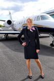 Stewardess in front of business jet