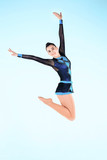 The girl doing gymnastics dance on a blue background