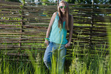 Girl posing on a background of a wooden fence