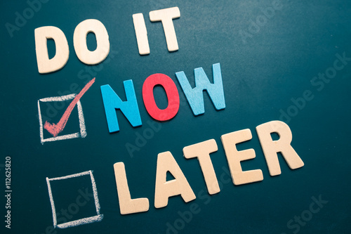 Do It Now or Later with checkbox and red check on blackboard Poster