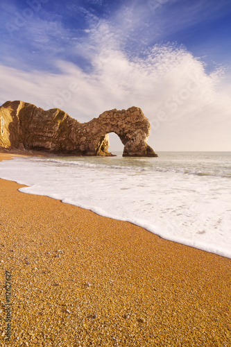 Poster Durdle Door arch in Southern England on a sunny day