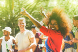 Fototapety Multiracial young people dancing in forest party on summer time