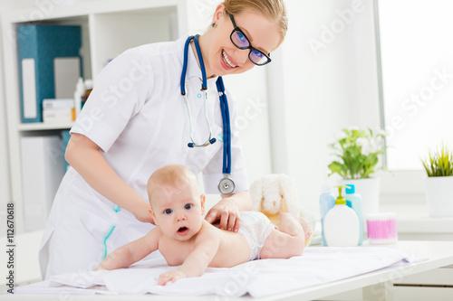 Fototapeta Doctor makes the baby massage