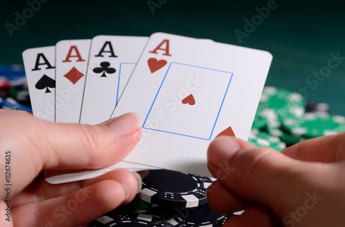 Poster Casino chips and four of kind combination in a woman's hand