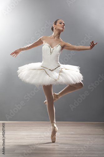 young ballerina in ballet pose classical dance Plakát