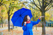 Beautiful young woman with blue umbrella