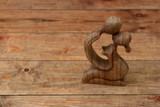 wooden figurine of couple