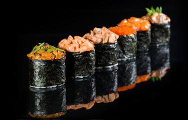 Gunkan sushi on a dark background