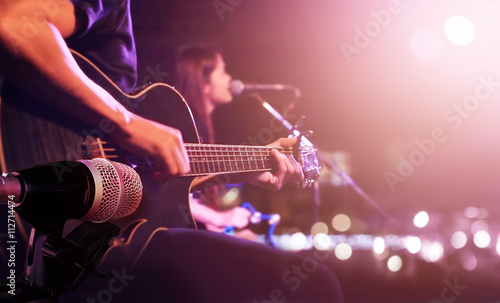 Guitarist on stage for background, soft and blur concept - 112714474