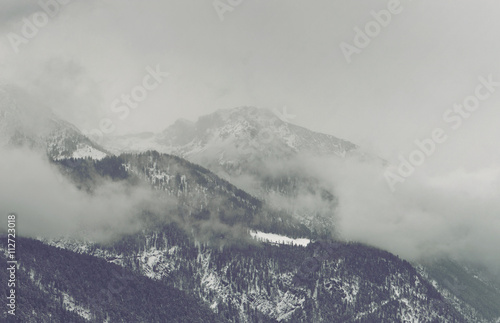 Dark clouds looming over mountain - 112723018
