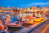 Old harbour of Heraklion with fishing boats and marina during twilight blue hour, Crete, Greece. Boats blurred motion on the foreground. - 112751498
