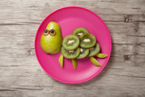 Funny turtle made of fruits on desk