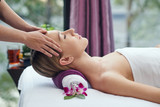 Chinese pretty woman receiving head massage in salon