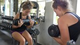 Sport Woman Doing Press Fitness Exercise at Gym on Machine