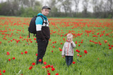 Father and son in a blooming tulip field
