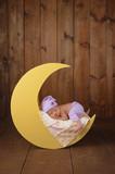 Fototapety Newborn Girl Sleeping on the Moon