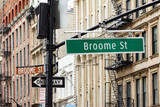 Broadway and Broome Street Signs in Soho Manhattan, New York City - 112889257