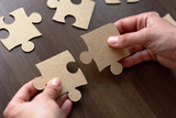 Folding puzzle hand parts on a wooden table