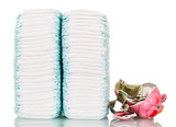 Stacks of diapers, broken piggy bank, money isolated on white.