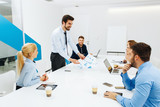 Young business people having a meeting in a conference room