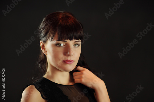 Aluminium Kapsalon beautiful young woman posing in a wedding dress on grey