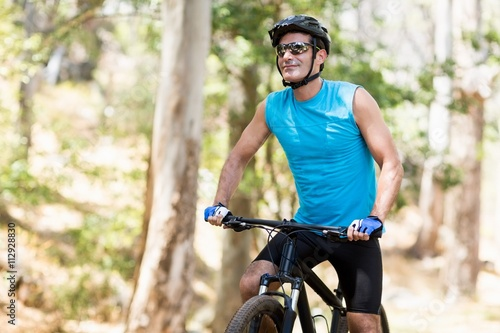 Man posing with his bike