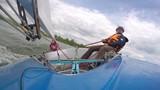 man drives sports yacht