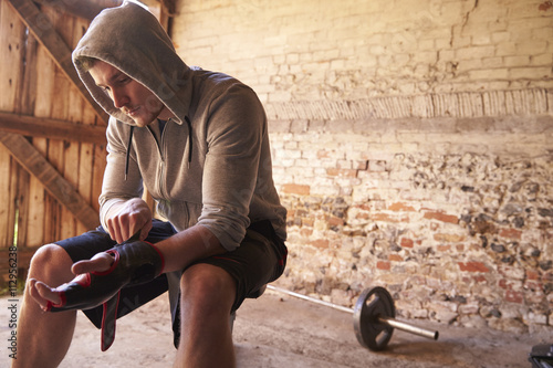 Poster Young Male Boxer Training In Gym