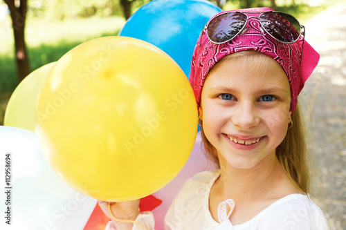 Poster Happy girl with colorful balloons.
