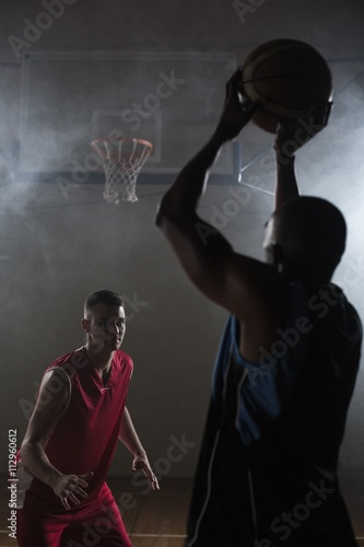 Zdjęcia Portrait of two men playing basketball