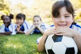 Close up view of girl lying on the floor with her soccer team