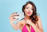Beautiful attractive stylish girl making selfie with smartphone