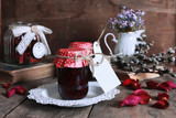rustic homemade jam jar wooden background and flower