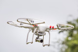 Drone equipped with camera flying in the air