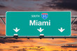 Interstate 95 South to Miami Highway Sign with Sunrise Sky
