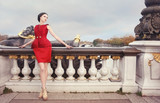 Woman in red dress, on Alexandre Bridge, Paris, France