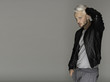 Confident and handsome. Handsome young man, platinum hair