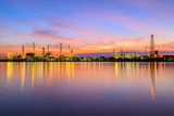 Oil refinery along the river at sunrise time (Bangkok, Thailand)