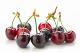 Horizontal making red cherries on white
