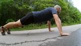 Push ups workout.  man making pushups  outdoor.