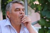 Sad and smoking man