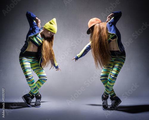 A collage of two photos with dancing girl in a tracksuit - 113157017