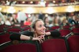 Woman in auditorium of teatre