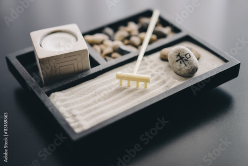 Fotobehang Stenen in het Zand Zen garden with sand, rake, stones, and candle