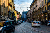 Broad Street with tram track among old houses in Milan, Italy.