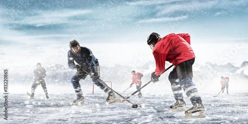 fototapeta na ścianę Playing hockey game