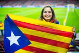 Female football fan with flag
